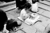 Hong Kong, little girl working with materials in stepped street