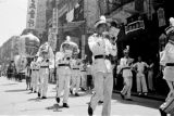 Hong Kong, marching band moving through city street