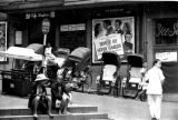 Hong Kong, rickshaws parked in front of Café Windsor