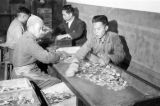 China, laborers sorting newly minted coins into boxes at the Chinese Mint in Shanghai