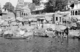 India, people bathing at ghat along Ganges River in Varanasi