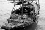 Hong Kong, children sitting on deck of houseboat