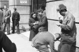 China, people exchanging money in front of building in Shanghai