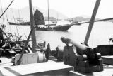 Hong Kong, mounted cannon and engine on deck of Chinese junk