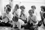 Cambodia, worshippers praying at temple