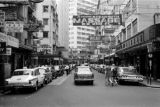 Hong Kong, cars parked along shops in business district