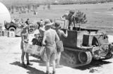 Hong Kong, Royal Army Service Corps soldiers loading tank with supply crates