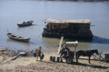 Baghdad (Iraq), flatboat moored near wagon at river's edge