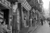 Hong Kong, view uphill of stores on commercial street