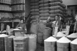 Hong Kong, merchants at shop selling grain from sacks and barrels