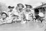Cambodia, group of Cambodian soldiers riding in back of truck