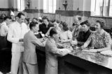 Hong Kong, bank tellers serving American evacuees during World War II