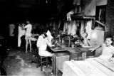 Hong Kong, men and boys operating sewing machines in shop