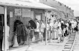 Hong Kong, travelers at train ticket booth at Lo Wu immigration control point