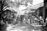 Hong Kong, British officers walking through village of Sha Tau Kok at border of mainland China