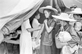 Hong Kong, woman receiving inoculation at border of mainland China