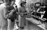 Hong Kong, American evacuees looking at jewelry store window display