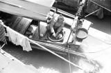 China, woman preparing food on sampan docked in Shanghai
