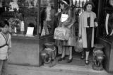 Hong Kong, American evacuees looking in shop window