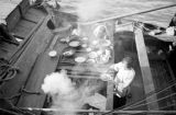 Hong Kong, people preparing meal on houseboat docked at pier