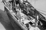 China, overhead view of men on junk docked in Shanghai