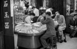 Hong Kong, men talking at counter in jewelry store
