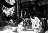 India, men looking at bicycles outside shop in New Delhi