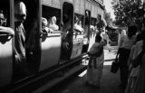 India, passengers on streetcar in New Delhi