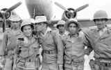 Vietnam, Algerian troopers waiting to board plane during First Indochina War
