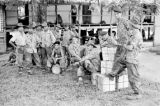 Vietnam, soldiers gathered outside building during First Indochina War
