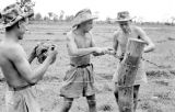 Vietnam, German Legionnaire Paratroopers stringing barbed wire during First Indochina War
