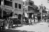 India, pedestrians and horse-drawn carts on New Delhi street
