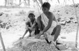 India, laborers crushing rock by hand at quarry