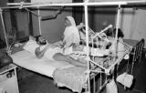 India, woman visiting man at New Delhi hospital
