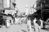 Pakistan, crowded Peshāwar market with view of Ghanta Ghar (Cunningham Clock Tower)