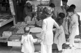 Pakistan, children at vending stand in Peshāwar