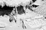 Philippines, Igorot woman with mortar and pestle on northern Luzon island