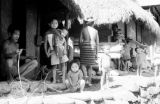 Philippines, Igorot people near hut on northern Luzon island