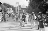 Pakistan, crowded marketplace in Peshāwar with view of Chowk Yadgar