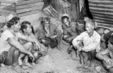 Philippines, Igorot men at hut on northern Luzon island