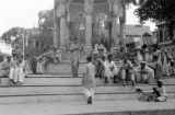 Pakistan, men resting on Chowk Yadgar steps at Peshāwar market