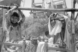 Pakistan, girls riding ferris wheel at Peshāwar market