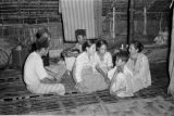 Indonesia, family inside home on Sumbawa Island