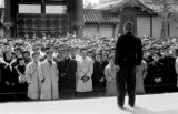 Japan, man speaking to uniformed men and women in Kyoto