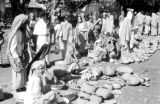 Indonesia, merchants selling goods at market on Sumbawa Island