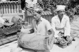 Indonesia, men in orchestra playing music for Balinese dancers