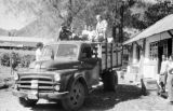 Indonesia, Harrison Forman riding mail truck bound for Ende
