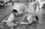 Indonesia, man teaching boy woodworking at Ruteng mission school