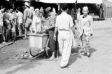 Indonesia, street vendor selling goods from cart in Banjarmasin street