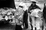 Japan, people unloading fabric from truck to wash in river